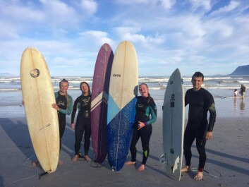 RIDING THE WAVES: Surfing in Muizenberg, South Africa.