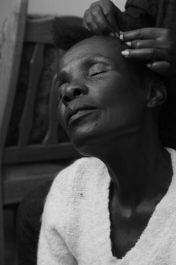 DOWNTIME: Hawa is patiently sitting down while getting her hair done.