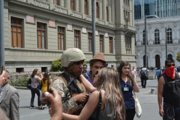 FACE OFF: Protesters confronting a solider in Santiago.