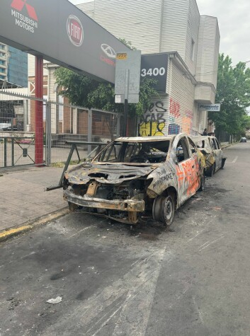 VANDALISM: The protesters put fire to several buses and cars during the riots